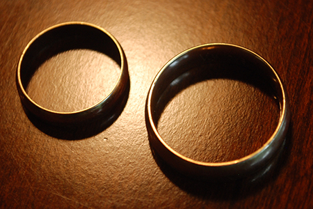 Photo of a man and woman's wedding bands